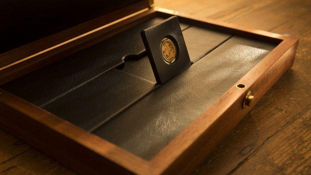 Box with 1899 Half Sov